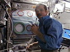 Chris Hadfield sets up the<br /> Microgravity Science Glovebox for<br /> the Coarsening in Solid Mixtures-2<br /> experiment in conjunction with the<br /> Payload Operations Center at the<br /> Marshall Space Flight Center.<br /> Credit: NASA TV